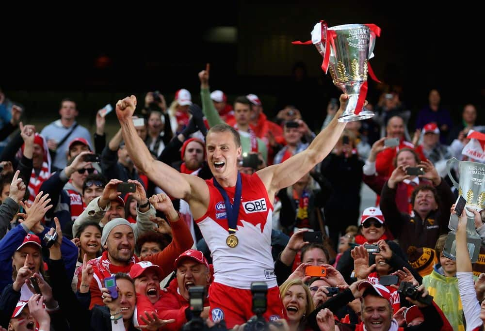 Ted Richards holds the 2012 premiership cup aloft after the Swans' victory over Hawthorn