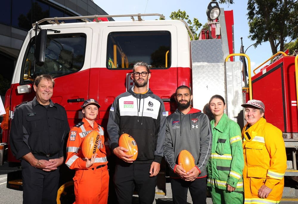 Brodie Grundy and Adam Saad with members of the CFA and SES ahead of the State of Origina bushfire relief match