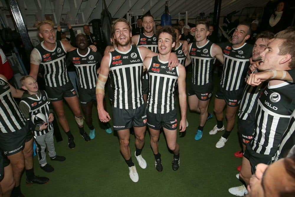 Jack Watts and Lewin Davis sing the Port Adelaide Magpies song in 2018. Picture: AFL Photos