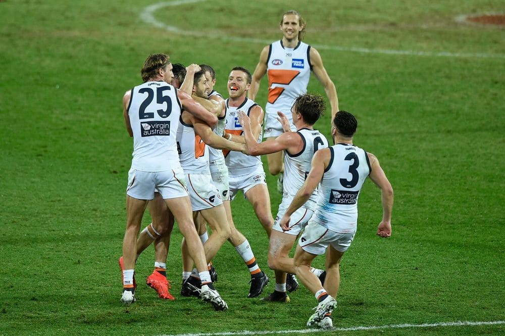 The Giants celebrate Callan Ward's late goal against the Bombers. Picture: AFL Photos