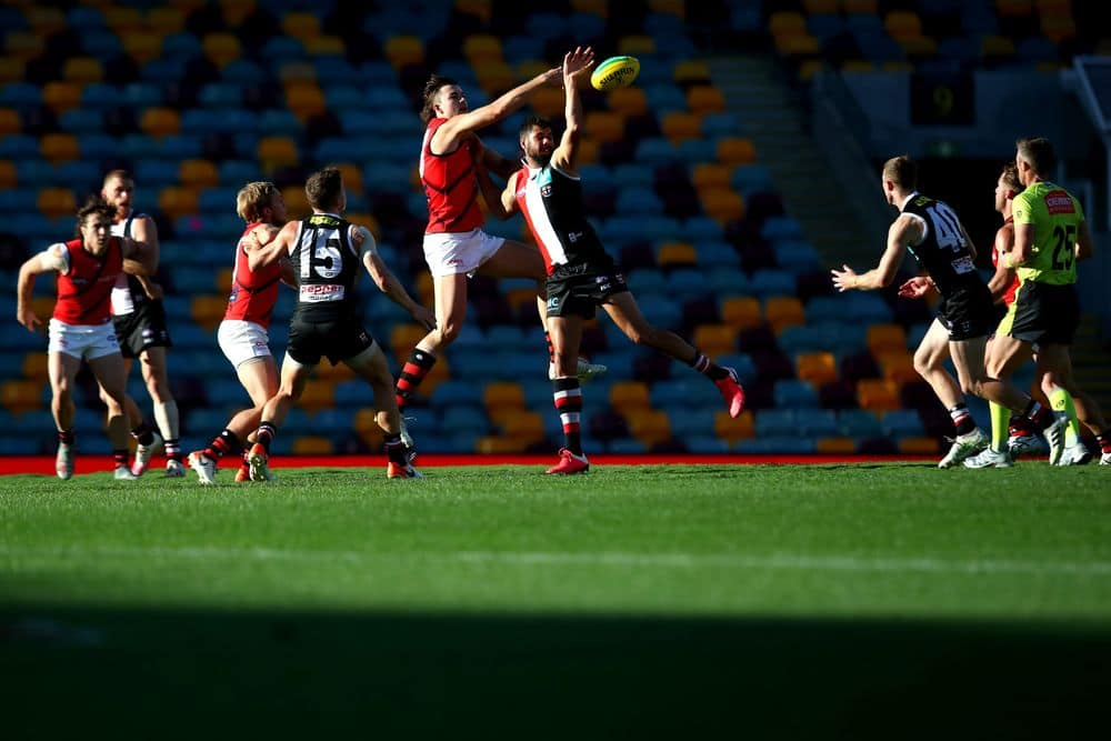 Sam Draper and Paddy Ryder compete in the ruck. Picture: AFL Photos