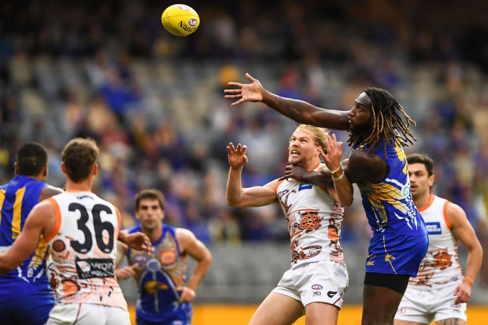 Nic Naitanui and Harry Himmelberg fight for first use of the ball. Picture: AFL Photos