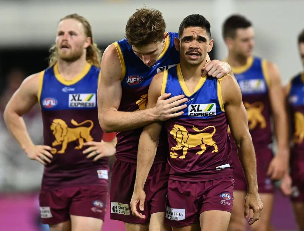 Lion Harris Andrews (centre) consoles teammate Charlie Cameron after last year's preliminary final loss. Picture: Getty Images via AFL Photos