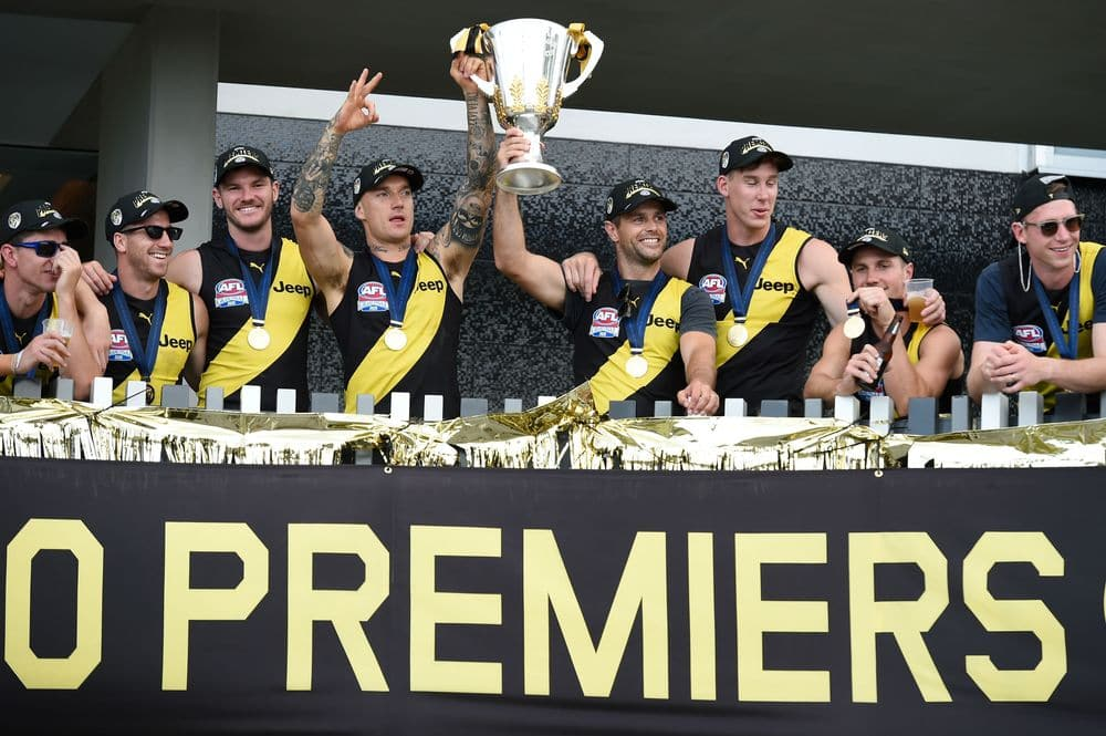 Dustin Martin and Trent Cotchin hold the premiership cup aloft at the Tigers' Gold Coast accommodation on Sunday. Picture: Getty Images/AFL Photos