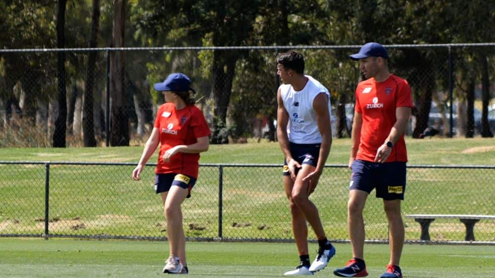 Melbourne defender Marty Hore walks from Casey Fields after injuring his left knee on Friday. Picture: AFL Media vision