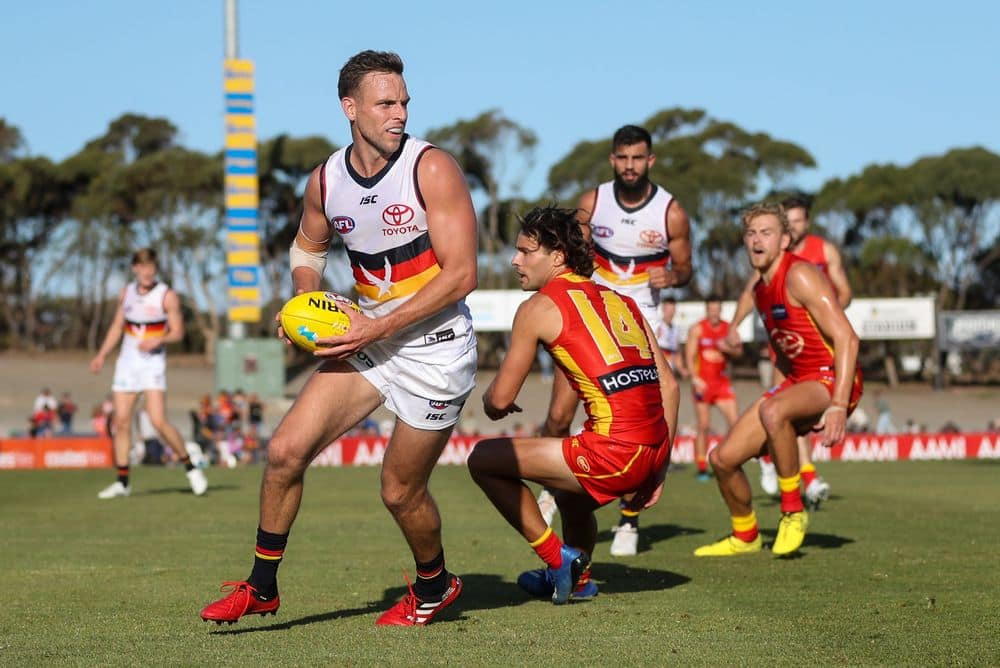 Adelaide's Brodie Smith dodges Gold Coast's Lachie Weller in the 2020 pre-season. Picture: Getty Images/AFL Photos