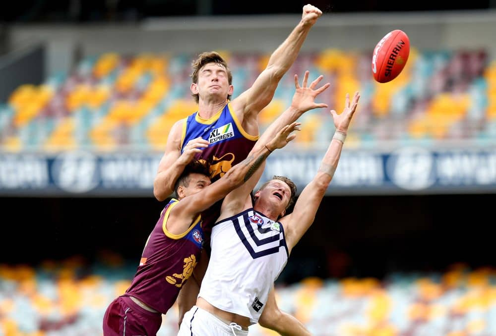 Harris Andrews flies over the pack for a spoil. Picture: AFL Photos