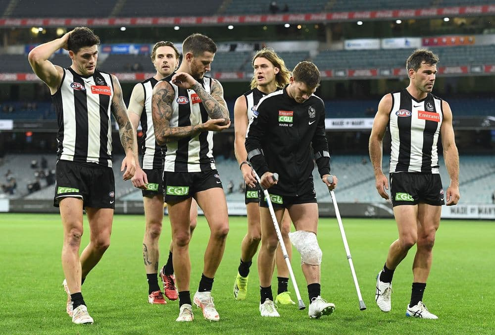 Collingwood's Taylor Adams leaves the field on crutches after injuring his knee against GWS in round four on April 10, 2021. Picture: AFL Photos
