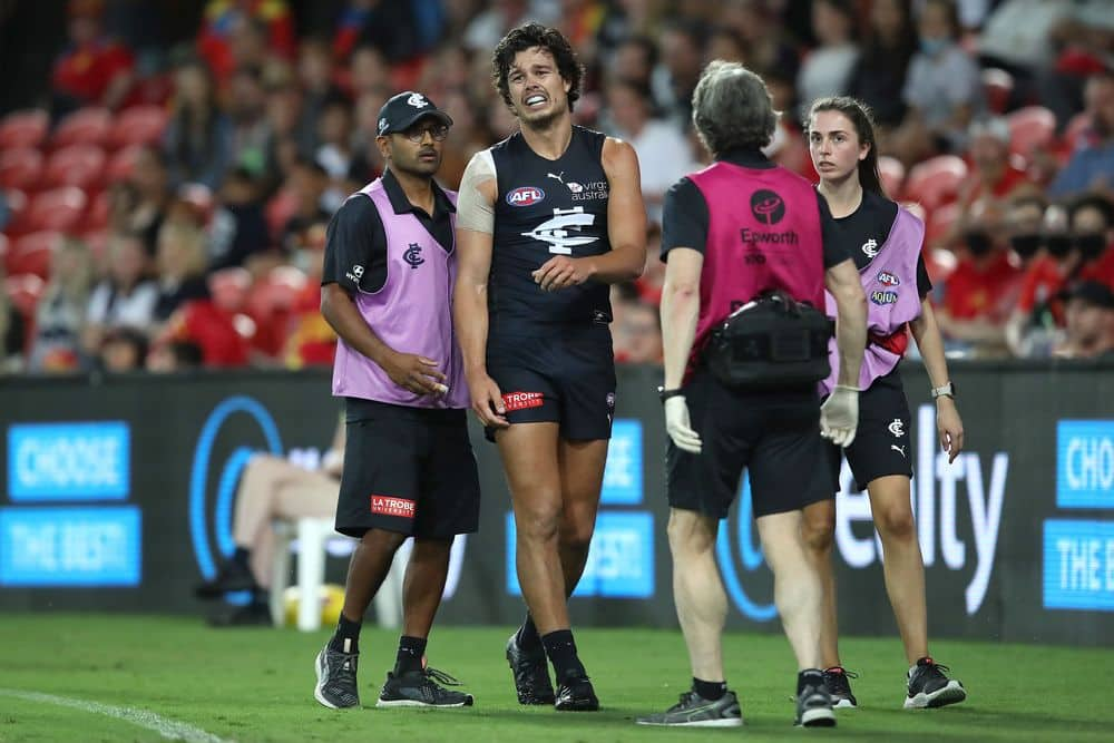 Carlton's Jack Silvagni leaves the field after injuring his shoulder against Gold Coast in round four on April 10, 2021. Picture: AFL Photos