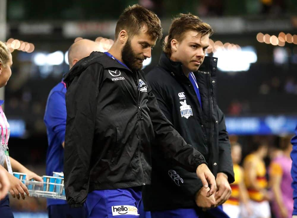 North Melbourne's Luke McDonald and Cam Zurhaar head to the bench after being ruled out of the clash against Adelaide. Picture: AFL Photos