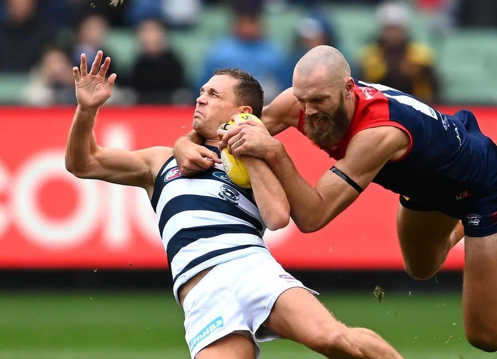 Geelong skipper Joel Selwood is tackled high by Melbourne captain Max Gawn. Picture: Quinn Rooney, Getty Images
