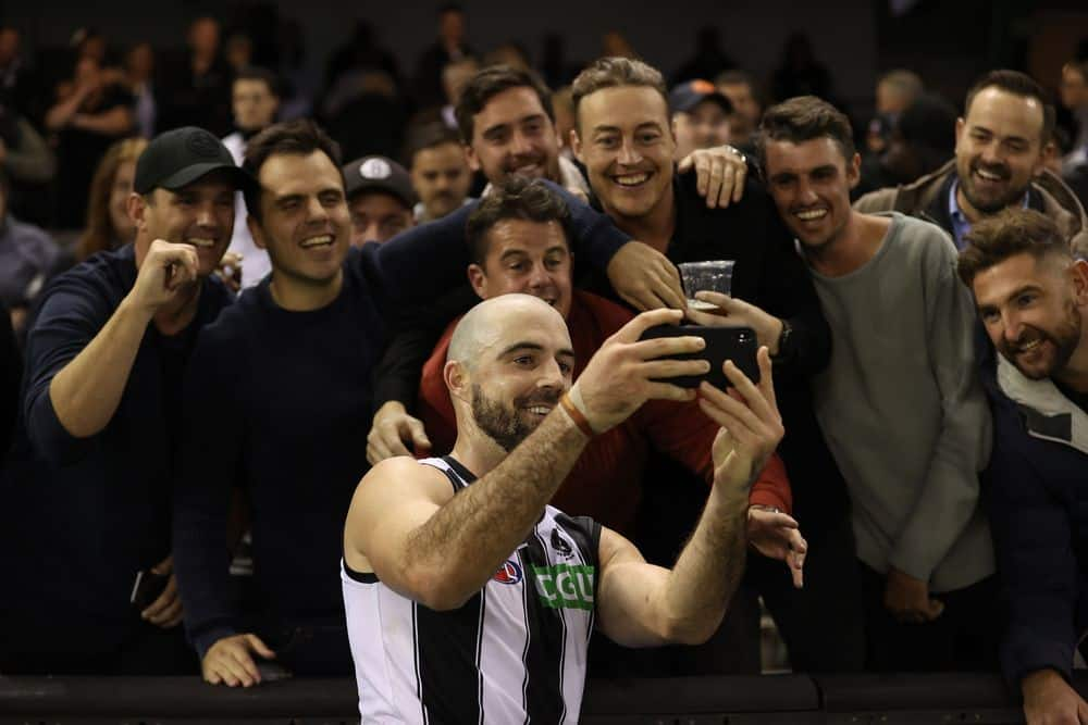 Steele Sidebottom takes a selfie with fans after Collingwood's round eight win over North Melbourne at Marvel Stadium on May 8, 2021. Picture: Getty Images