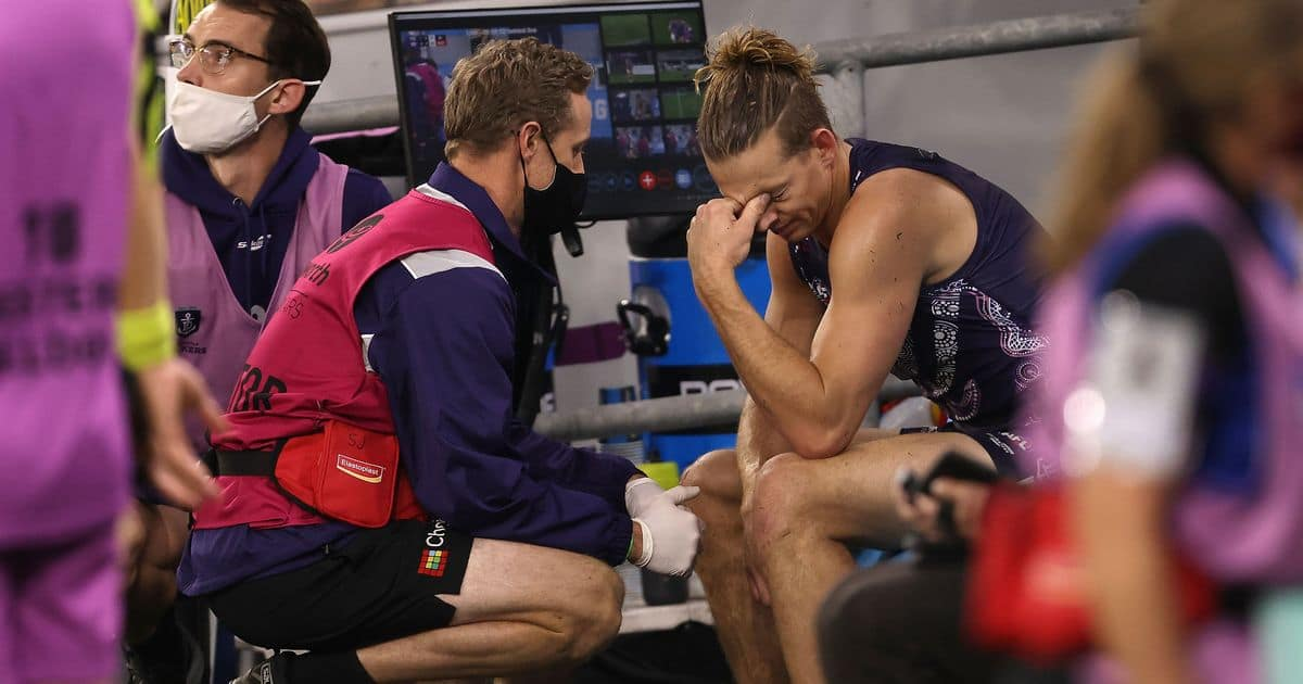 Fremantle star Nat Fyfe looks dejected on the bench after injuring his shoulder in round 12 2021 JPG?width=1200&height=630.