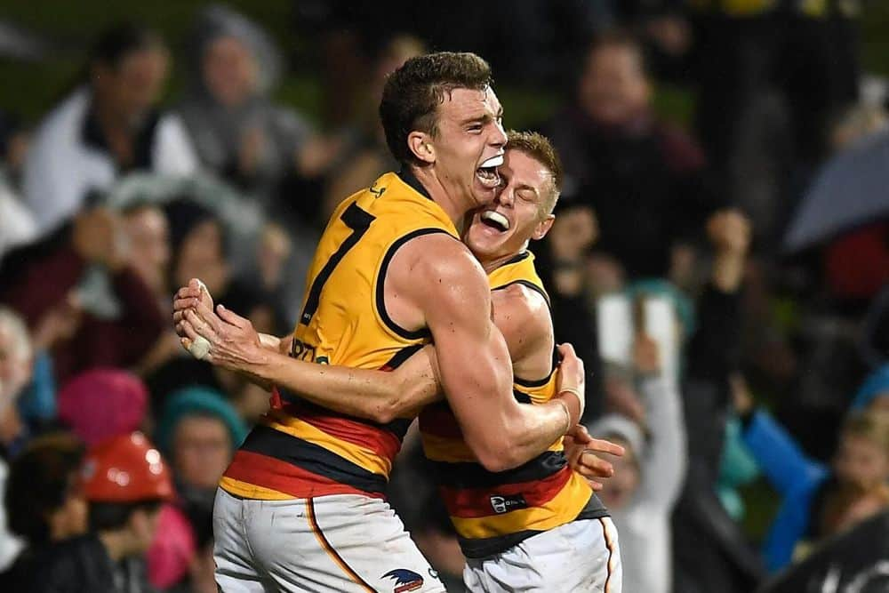Adelaide's Riley Thilthorpe and David Mackay celebrate Thilthorpe's match-winning goal against St Kilda in round 13, 2021. Picture: Albert Perez, AFL Photos