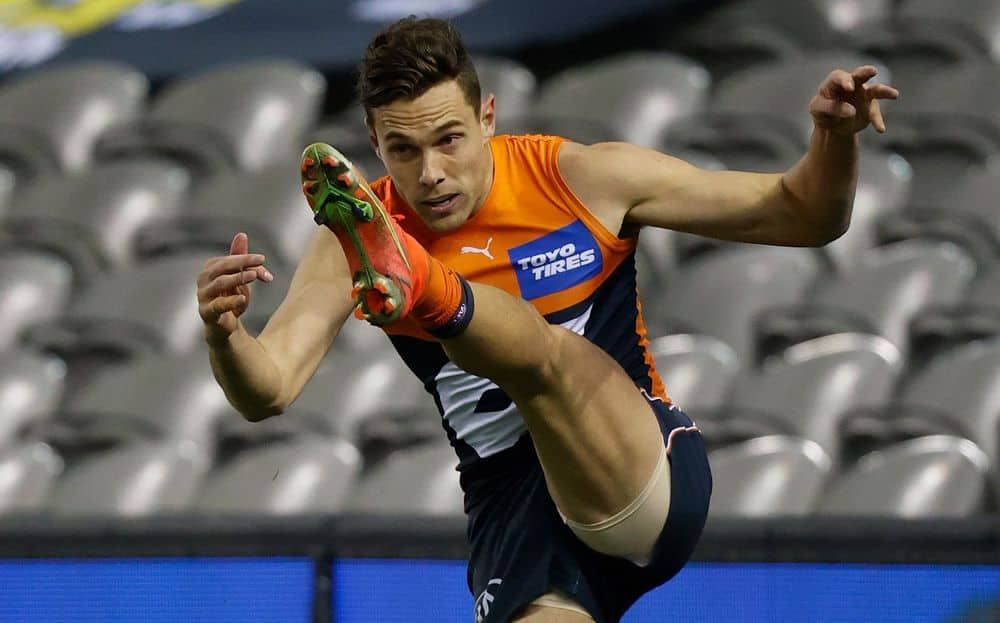 Giants star Josh Kelly gets a kick away against the Tigers in round 22, 2021. Picture: AFL Photos