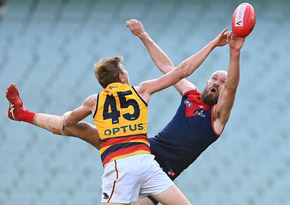 Kieran Strachan and Max Gawn compete in the ruck in round 22, 2021. Picture: AFL Photos
