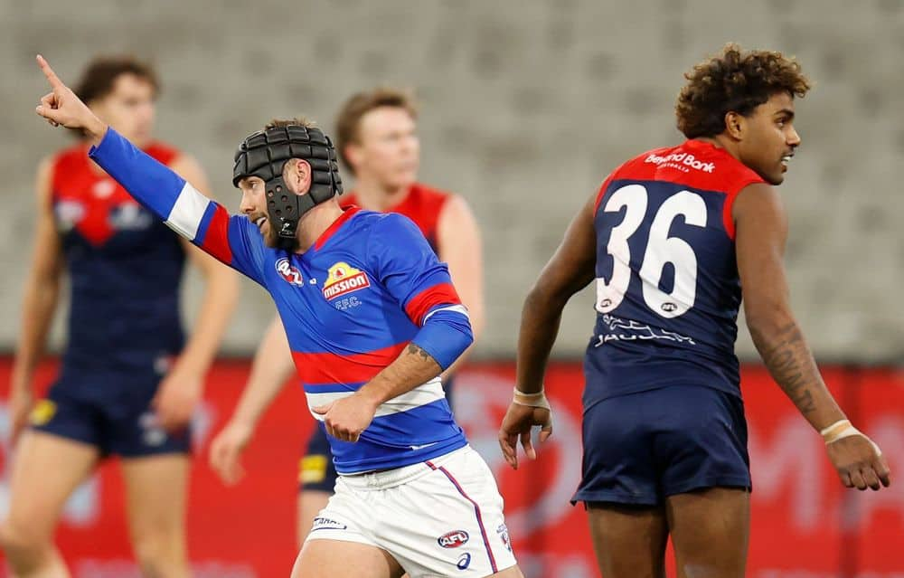 Bulldog Caleb Daniel celebrates a goal against Melbourne in round 19, 2021 as Demon Kozzy Pickett looks on. Picture: AFL Photos